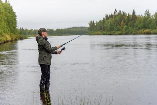 Woman fishing on river