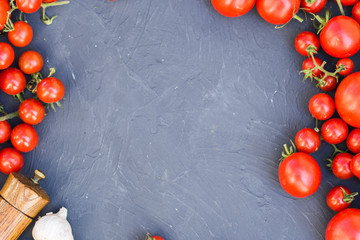 Fresh grape tomatoes with basil and garlic, pepper.