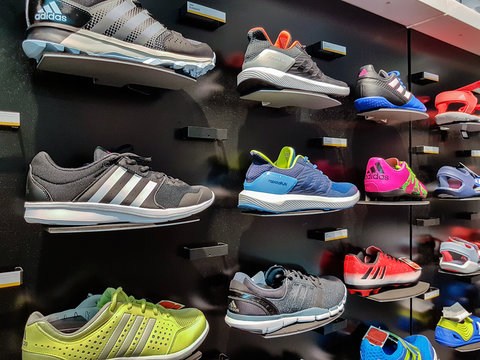 Nowy Sacz, Poland - August 12, 2017: Collection of trendy Adidas sports shoes offered for sale in the Adidas Shop. Adidas AG is a German multinaitional corporation that manufactures sportswear