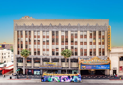 Hollywood and facade of famous cinema el Capitan and Chirardelli disney place by day