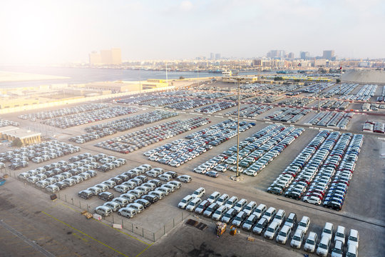 New cars in rows stored at port Rashid in Dubai, UAE