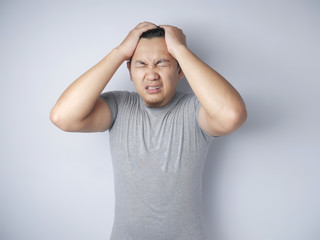 Young Man Frustrated, headache, stress and dizzy gesture