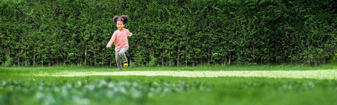 African black girl kid running on backyard with happy and fun