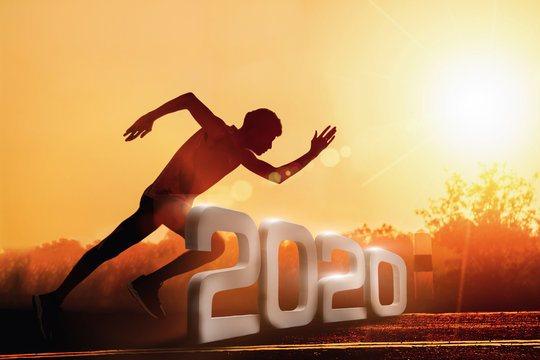 Man fitness silhouette at sunrise, Jogging workout wellness, Happy New Year 2020 concept. - Image