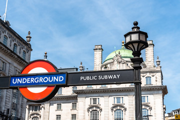 Low angle view of Underground sign in London. Picadilly Circus Station