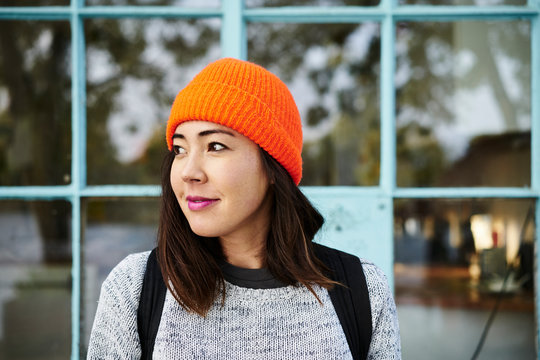 Young woman with orange beanie