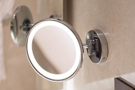 Bathroom cosmetic beauty mirror with halo rim lighting.