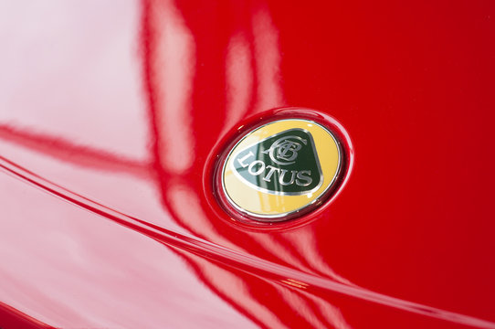 Mulhouse - France - 9 October 2019 - Closeup of logo on red Lotus Elise at retailer showroom