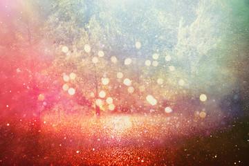 Fototapete - concept background photo of light burst among trees and glitter golden bokeh sparkles