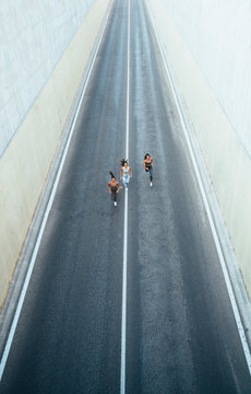 High angle view of athletes running on street