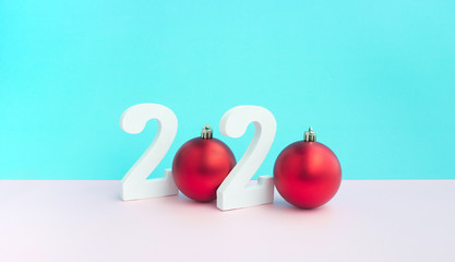 Christmas festival concepts ideas with mock up 2020 text number and red ball ornament on pastel color background.For decoration celebrate card d