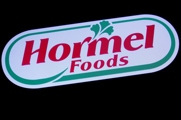 The company logo for Hormel Foods is displayed on a screen on the floor at the NYSE in New York