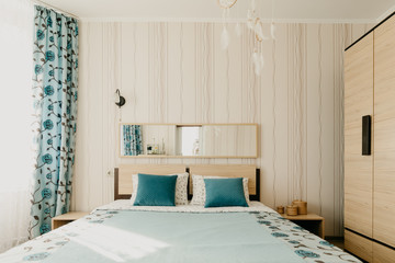 cozy bedroom in beige and turquoise shades