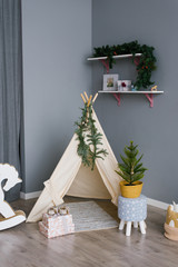 Children's wigwam and Christmas tree in the nursery