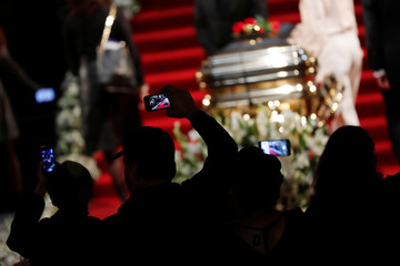 Fans take pictures of the coffin as they pay tribute to late Mexican singing legend Jose Jose at Bellas Artes Palace in Mexico City