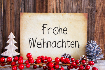 Paper With German Text Frohe Weihnachten Means Merry Christmas. Christmas Decoration And Wooden Background