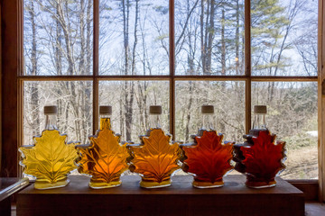 Various Grades Of Delicious Vermont Maple Syrup Lined Up On A Windowsill