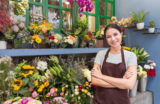 Startup successful sme small business entrepreneur owner asian woman standing with flowers at florist shop. Portrait of caucasian girl successful owner environment friendly concept with copy space