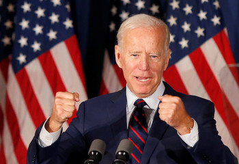 Democratic 2020 U.S. presidential candidate and former Vice President Joe Biden pumps his fists as he speaks at a campaign town hall meeting in Rochester