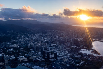 Aerial Photo Of The Sun Rising Over The Mountains And The City Of Honolulu, Oahu, Hawaii, USA
