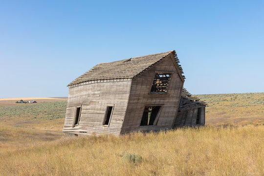 Abandoned farmhouse in grassland