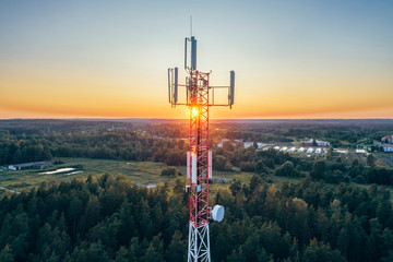 Mobile communication tower during sunset from above. Fotomurales