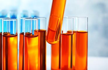 Fototapete - Taking test tube with liquid sample, closeup