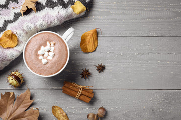 Fotobehang Chocolade Flat lay composition with cup of hot drink on grey wooden table, space for text. Cozy autumn atmosphere