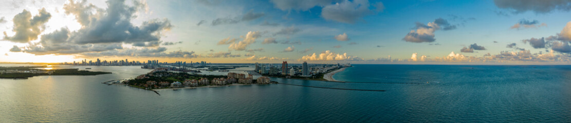 Wall Mural - Aerial drone panorama Miami Beach inlet sunset twilight shot
