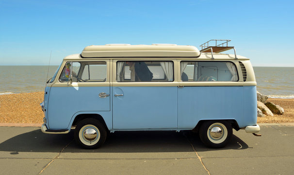 Classic Blue and white camper parked on Felixstowe seafront promenade.