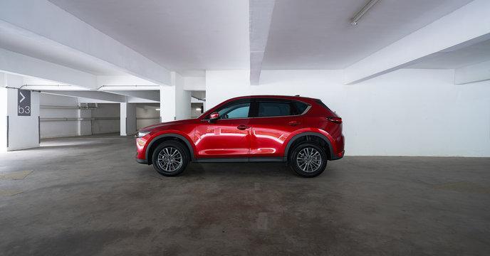 Kuala Lumpur, Malaysia - July 26, 2019: Mazda CX 5 side profile view. Modern crossover SUV parking in basement empty car park .