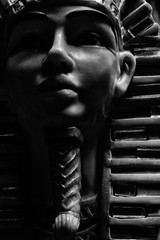 Black and white pharoah statue face close-up.