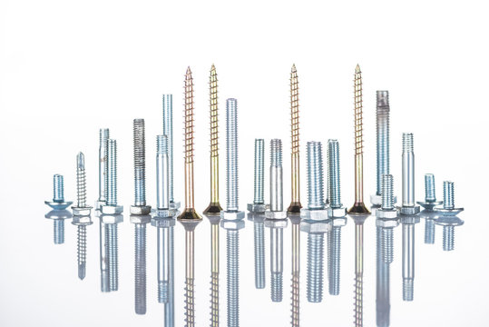 shiny metallic studs and bolts isolated on white