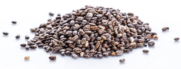Heap of Chia seeds isolated on white background.