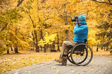 wheelchair - disabled photographer in autumn park
