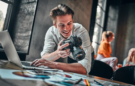 Young cheerful photographer