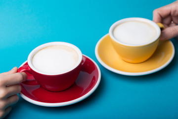 yellow and red cup on a blue background