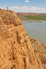 Red clay erosion gully and river. Eroded landscape. Spain