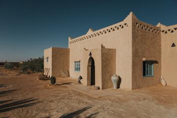 Adobe house in Sahara desert in Morocco, Africa.