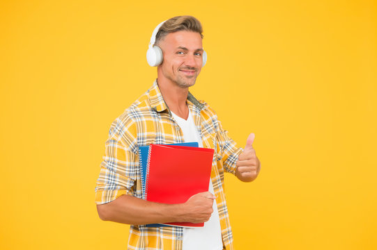 Another way of study. Learning english. Educational technology. Study. Audio book concept. Worldwide knowledge access. Audio library. Man handsome college student headphones books. Study languages
