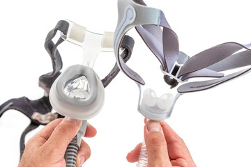Doctor demonstrating Treatment of sleep apnea and snoring for patient suffering from Obstructive Sleep Apnea Syndrome OSAS connected to a continuous positive airway pressure device CPAP