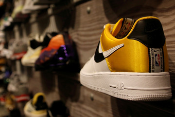 A pair of Nike's Air Force shoes with a NBA logo are seen display at a Nike store in Beijing