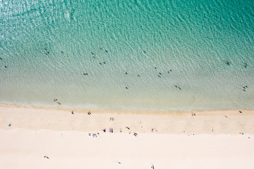 Top down view of peaple enjoying their time on a beach