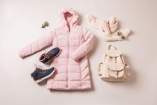 Winter outfit for women - pastel pink down jacket and accessories.