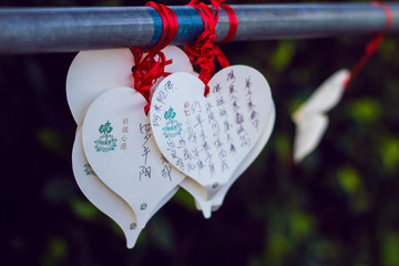 Colorful hearts with wishes on the territory of Nanshan temple near  Statue of Guanyin, Sanya, Hainan island, China