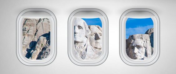 Wall Mural - Airplane interior with window view of Mount Rushmore, USA. Concept of travel and air transportation