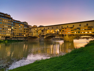 Old Bridge and Florence Lungarni at night. Panoramic cityscape in Autumn, Tuscany - Italy