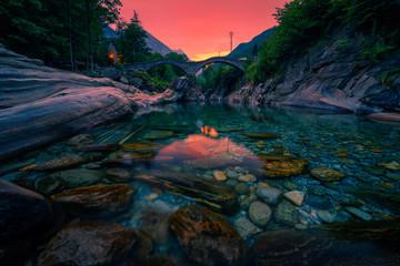 Sunset above the double arch stone bridge in Lavertezzo, Switzerland