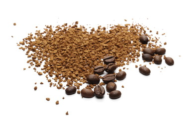 Instant coffee granules in heart shape and beans, isolated on white background