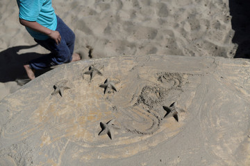 Anderson makes sand stars in the park near his home in Eugene, Oregon